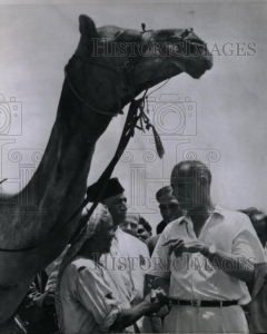 Visiting American Vice President, Lyndon Johnson, stops to meet a camel driver in Karachi in 1962. During the spontaneous conversation, Johnson invited the camel man (Bashir Ahmed) to visit the United States. In 1962 the American government funded Bashir's trip to the US. Bashir was soon taken to Johnson's private ranch in Texas. The US government then financed Bashir's trip to Mecca