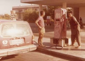 Swiss tourist gets his car's tank filled at a gas station on the Pakistan-Afghanistan border (1974).