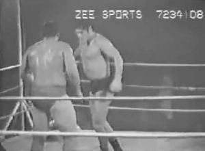 A video grab from PTV's live transmission of a wrestling match between top Pakistani wrestler, Akram Bholu, and Japanese wrestler, Anokhi in 1975. The match that took place in Pakistan was watched by thousands of people in the ground and by millions on TV. It was also telecasted live in Japan.