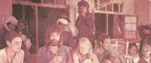 Western tourists pose with a group of locals outside a rest house in Ziarat in Balochistan (1974).