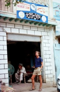 A German tourist outside a ' hashish shop' in the tribal areas of former NWFP (now Khyber Pakhtunkhwa), 1976. With the state of Pakistan having little influence in such areas, shops selling hashish sprang up when young western tourists began to pour into Pakistan from Afghanistan from the late 1960s onwards.
