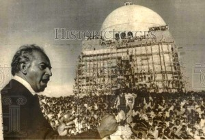 Zulfikar Ali Bhutto, addresses a rally at Muhammad Ali Jinnah's mausoleum in Karachi in 1969. (Photo courtesy of eBay.) The rally was held immediately after a protest movement led by leftist students; labour and journalist unions; political parties, including PPP and the National Awami Party (NAP), had forced Pakistan's first military dictator Ayub Khan, to resign. Construction of the mausoleum began in the early 1960s and was still underway when the rally was held. Wooden ladders and planks being used for construction purposes were acrobatically utilised by the crowd to gain vantage viewing points on the day of the rally.
