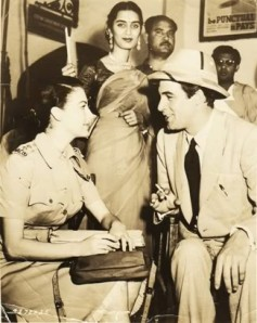Pakistani fans and artistes gather around the main cast of Bhowani Junction on the film's sets in Lahore.