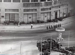 Army troops patrol the streets opposite Club Road and near PIDC building in Karachi, during the anti-Ayub Khan protest movement in 1969. The picture was taken by a foreign tourist from his room at the Hotel Intercontinental (now, Pearl Continental), which is situated diagonally opposite the PIDC building.