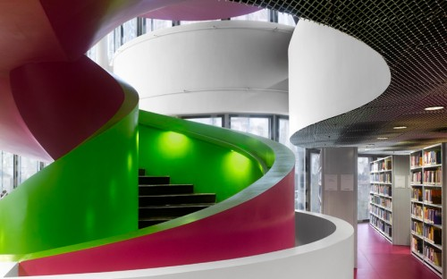 Designed by the Swiss firm of Herzog & de Meuron, the Cottbus library features brightly coloured concrete spiral staircases.
